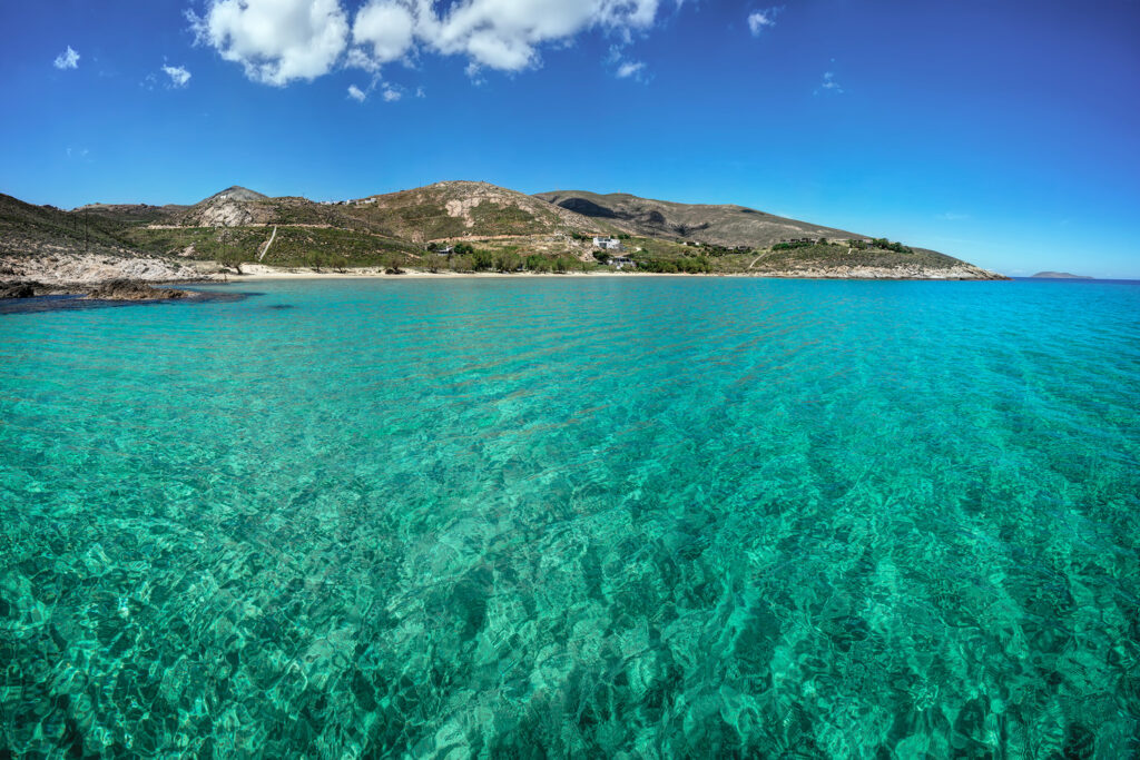 Magnificent clear transparent waters in Psili Ammos beach, Serifos island Cyclades Greece