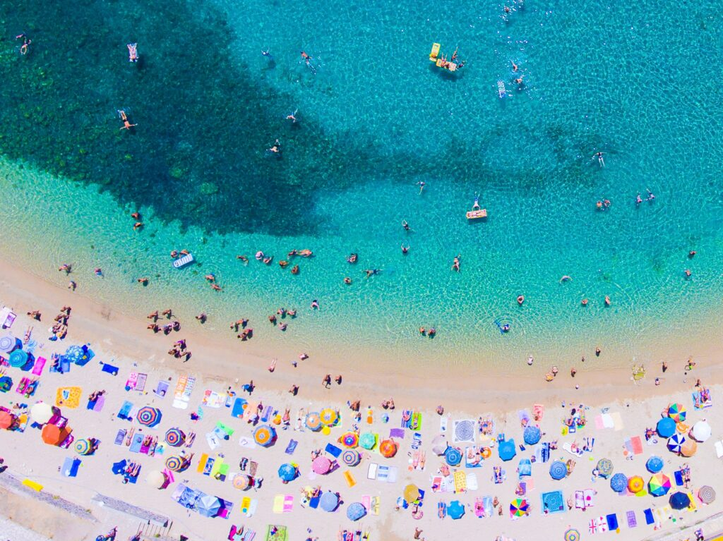 Travel to Corfu, Greece - drone view of beach with bathing people