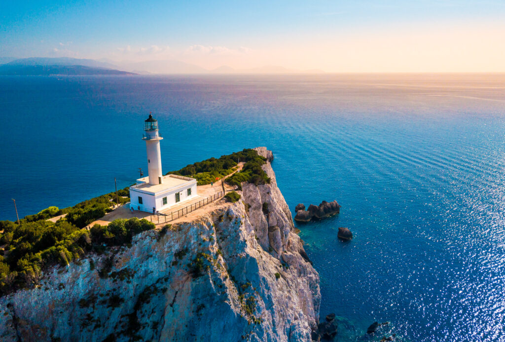 The lighthouse at the vertical cliff in Lefkada island, Ionian Sea, Greece