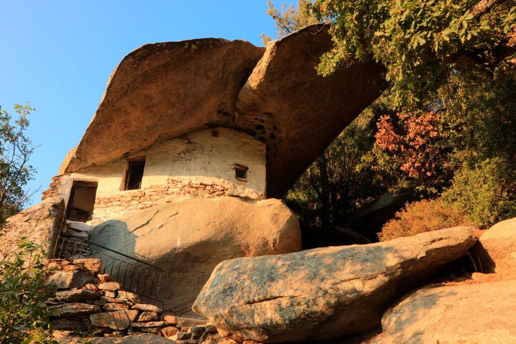 Historical Greek chapel Theoktistis with impressive overhanging rock-shelter, Ikaria, North Aegean Sea Greece