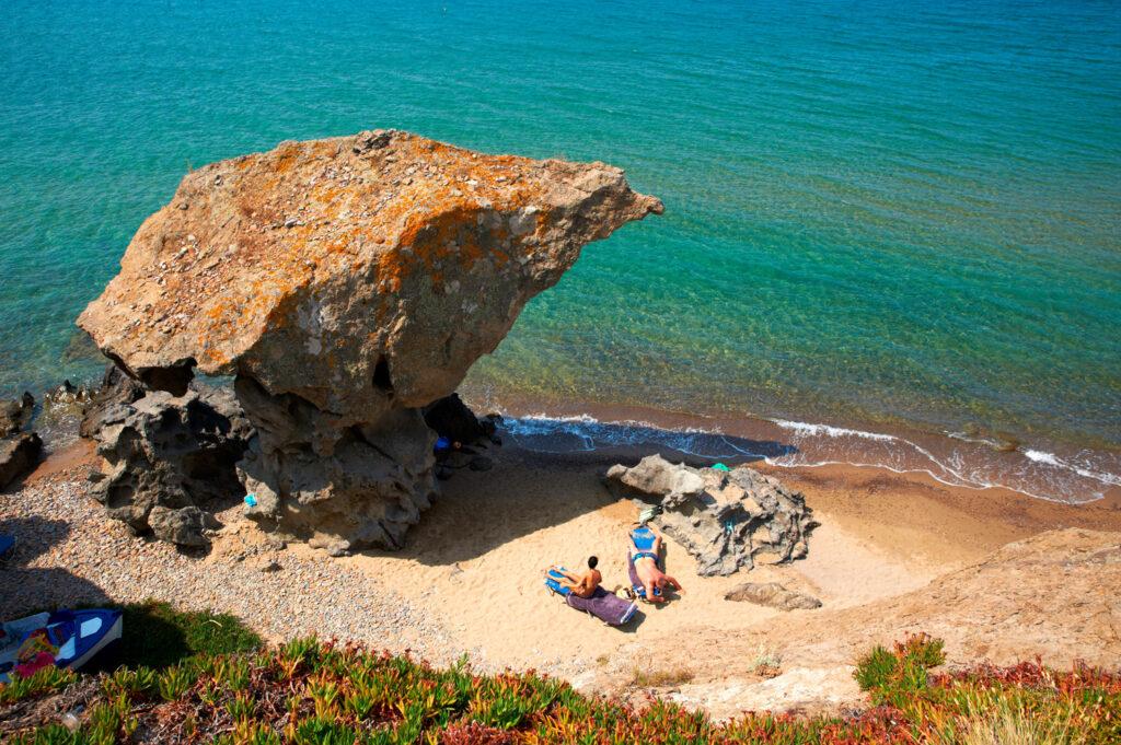People sunbathing at a beach in Lemnos island, North Aegean Greece