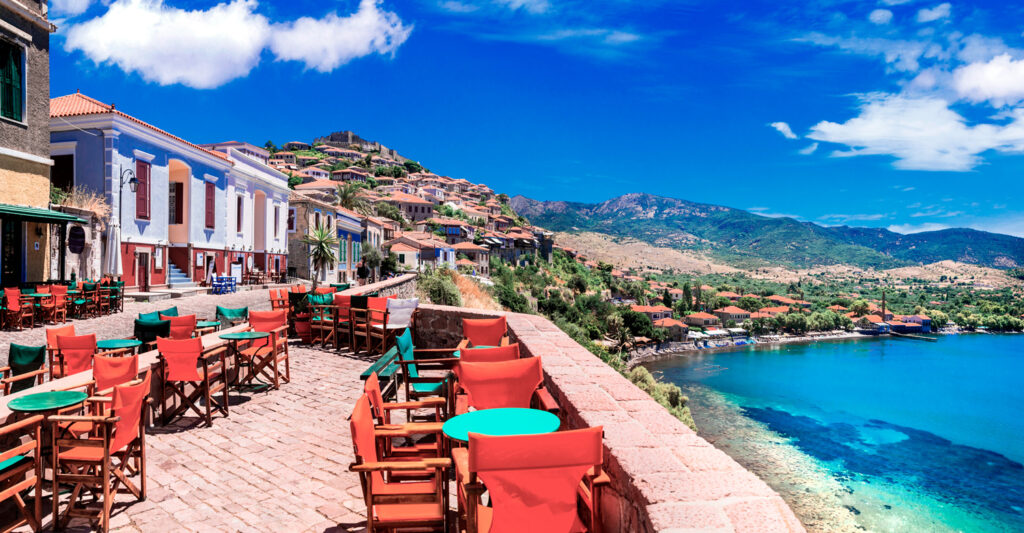 Traditional and colourful Molyvos with bar and taverna streets in Lesbos island, North Aegean Sea Greece