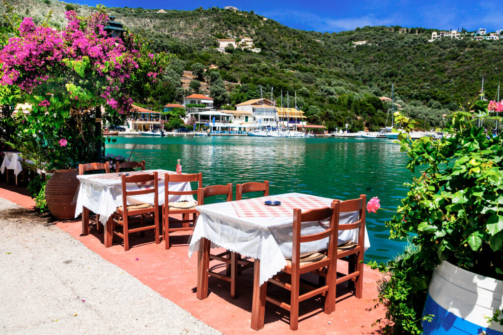 Traditional Greek restaurant by the sea, Sivota fishing village, Epirus, Greece