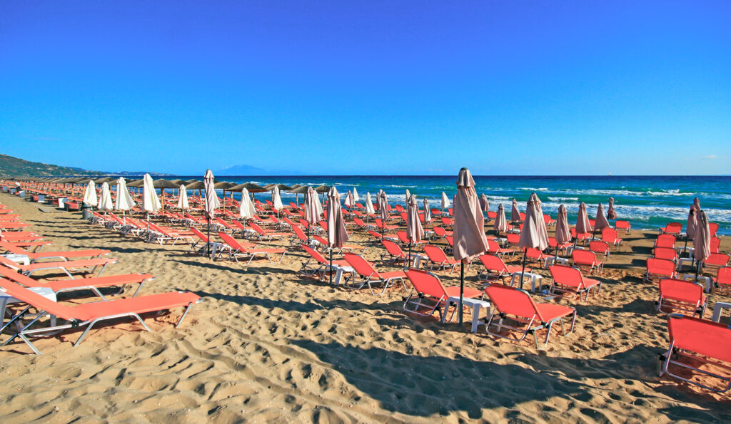 Banana beach with umbrellas and sundecks in Zakynthos, Ionian Sea Greece