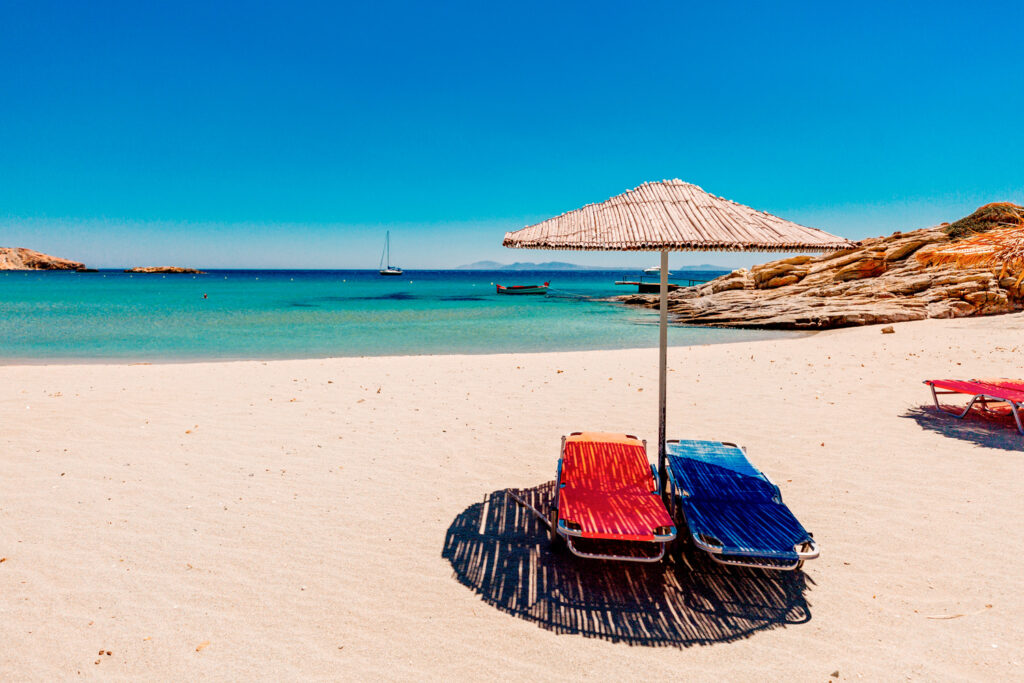 The sandy beach of Milopotas in Ios island, Cyclades Greece