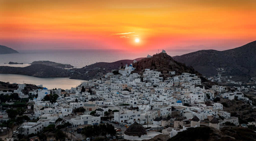 Panoramic summer sunset, view above Chora Ios, Cyclades Greece