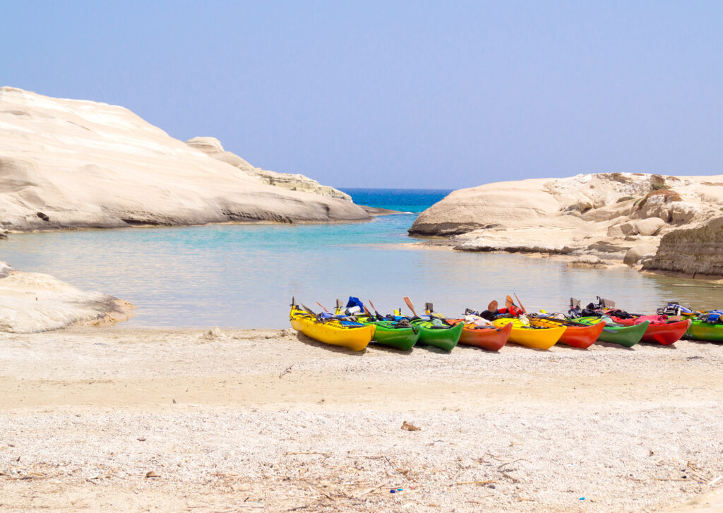 travel to Milos Greece, colourful canoes on the beach