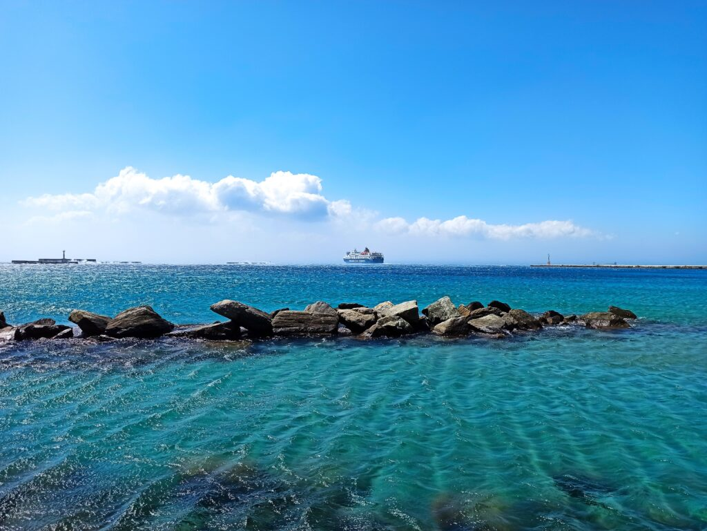 Travel to Tinos, Cyclades, Greece - View from the port - Photo by Irena Kefala