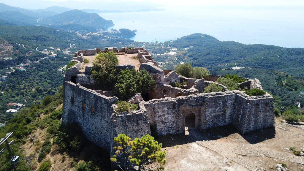 Aerial view of iconic castle of Ali Pasha overlooking bay and village of Parga, Epirus, Greece