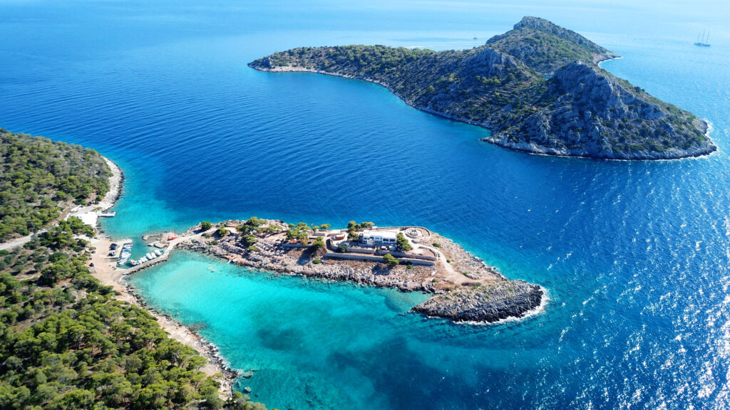 Agistri Saronic Gulf Greece - Aerial view of Aponisos beach and lake with turquoise blue water