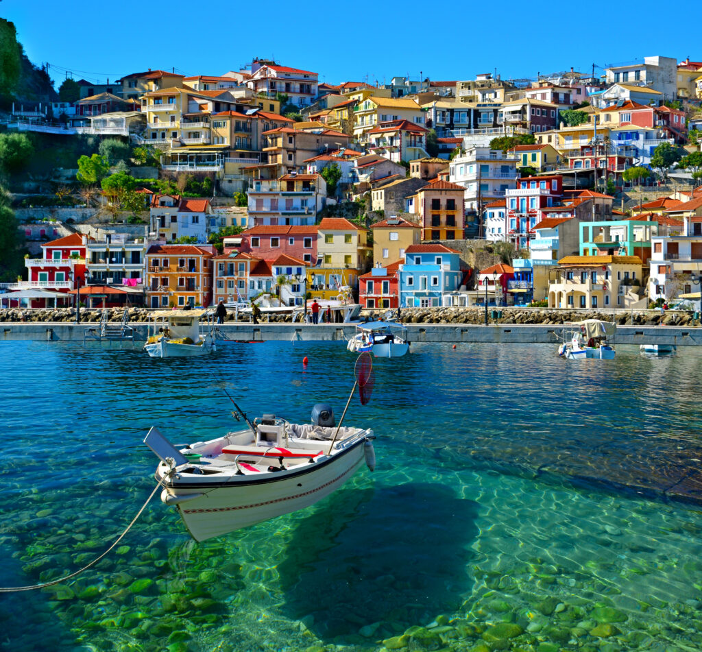 Parga boat, heaven on earth Greece holidays, clear sea and reflection - Preveza Greece