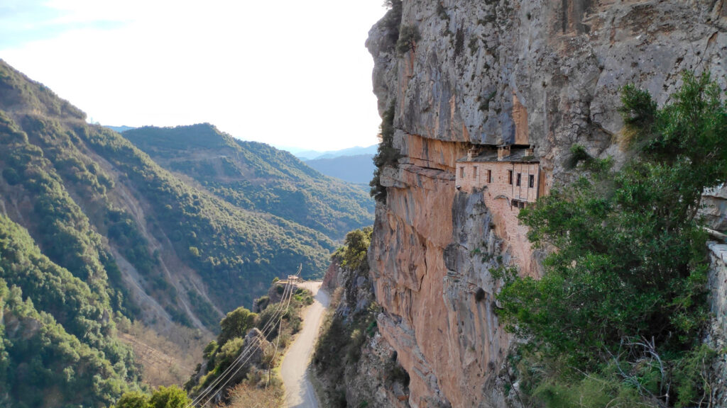 Ioannina Kipinas Ancient Architecture holy monastery hanging from a cliff in Tzoumerka Stone build inside a cave of mountain in 1212 close to pramanta, kalarrites, and syrrako villages