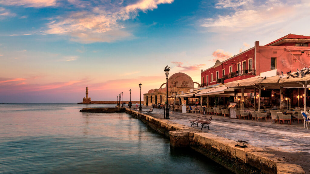 Venetian Harbour of the city of Chania at sunrise with turquoise water, Crete, Greece