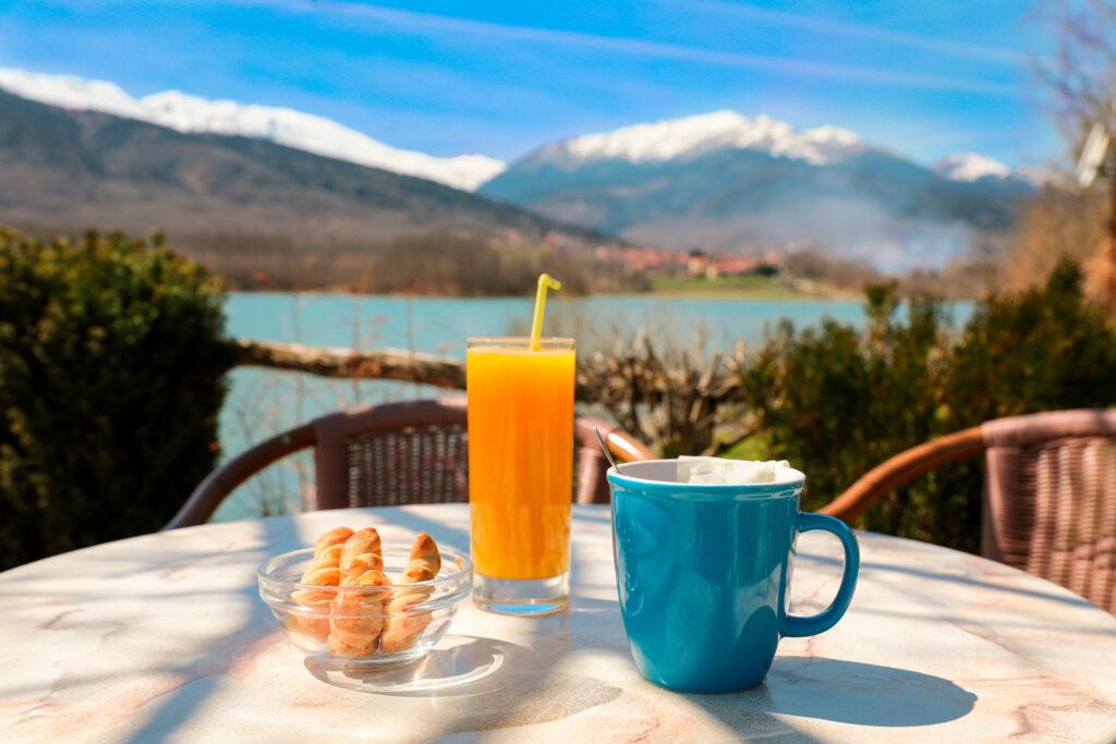 breakfast by the lake Plastiras with a view of the Agrafa mountains, Karditsa, Greece