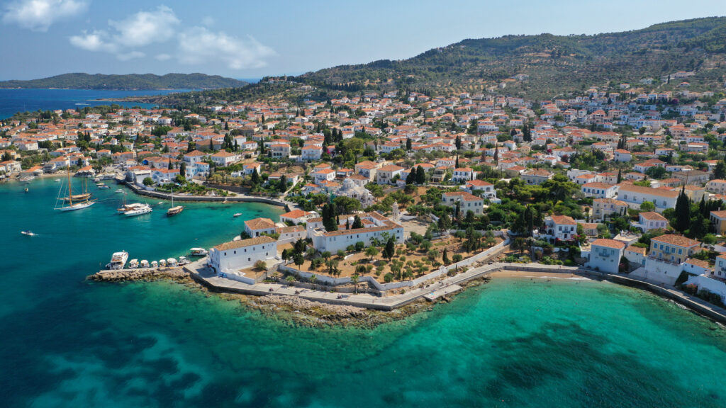 Picturesque chapel of Agios Mamas and three cannon monument in picturesque Spetses, Saronic Gulf, Greece