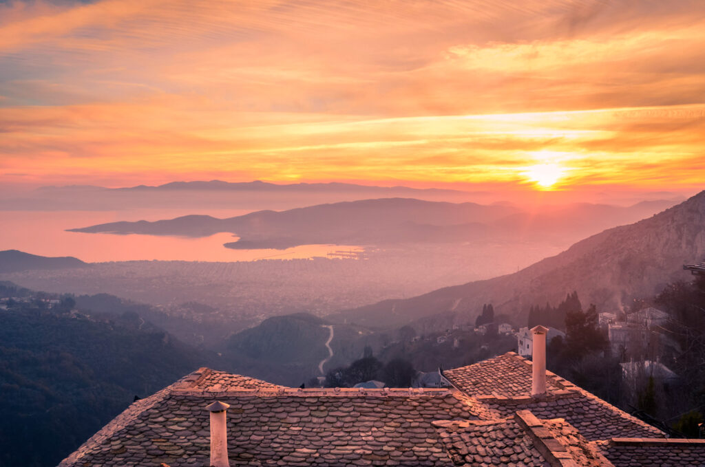 amazing-view-from-slate-roof-with-chimneys-of-a-traditional-house-in-pelion-on-the-city-of-volos-thessaly-greece