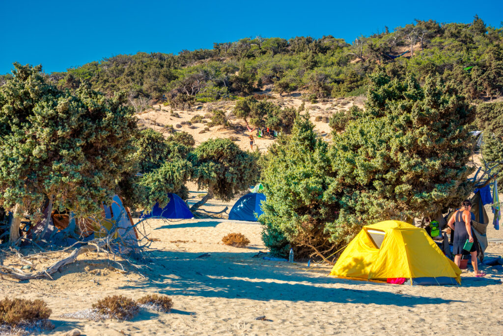 Camping tents under trees on Gavdos island, Crete, Greece