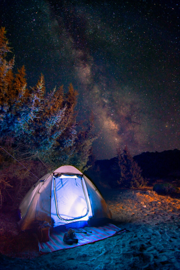 Illuminated tent at night with the Milky Way - Gavdos, Crete Greece