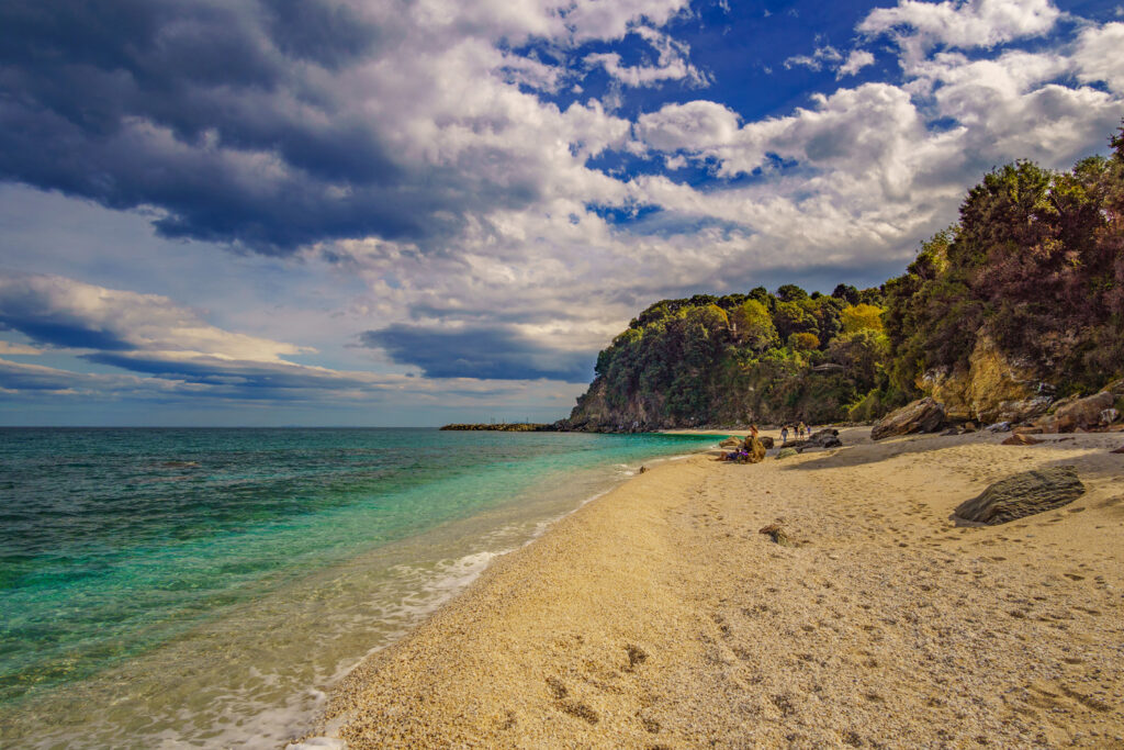 Plaka beach is one of the most amazing hidden beaches in Greece located near Agios Ioannis in Pelion Thessaly Greece