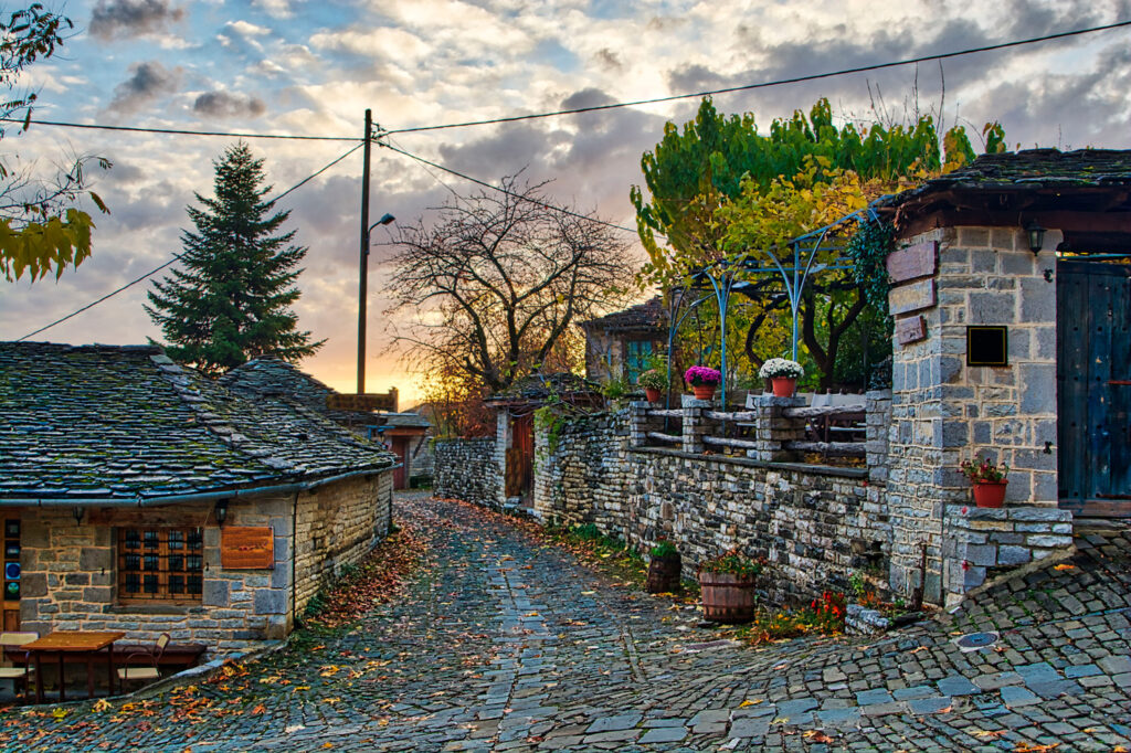 sunset-on-a-traditional-alley-in-megalo-papingo-village-in-ioannina-zagoria-greece