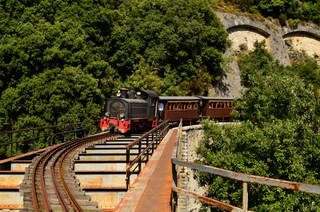 the Montzouris (smudgy) train in Pelion - train crossing a bridge, Thessaly Greece