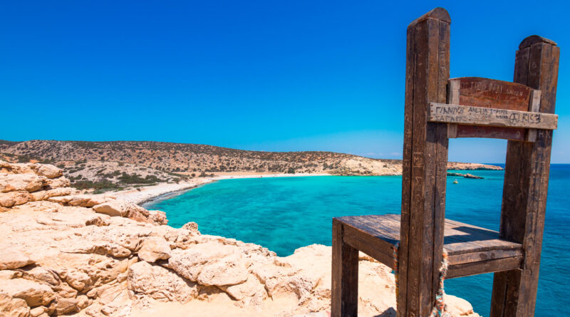 The tropical beach of Tripiti at the southernmost point of Gavdos island and Europe with the famous giant wooden chair, Greece