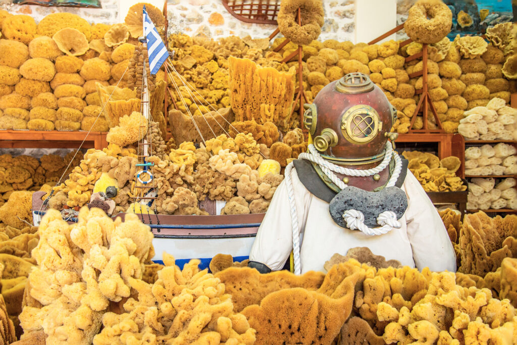 A vintage diving suit with helmet placed among natural sponges, Kalymnos island, Dodecanese Greece
