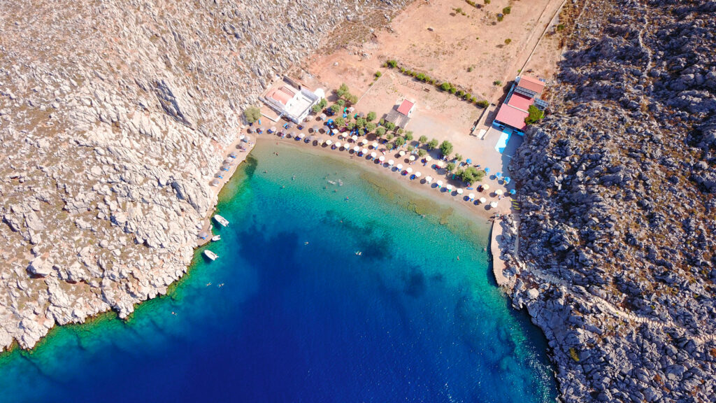 The famous tropical rocky beach of Agios Nicolaos with clear turquoise waters, Symi island, Dodecanese Greece