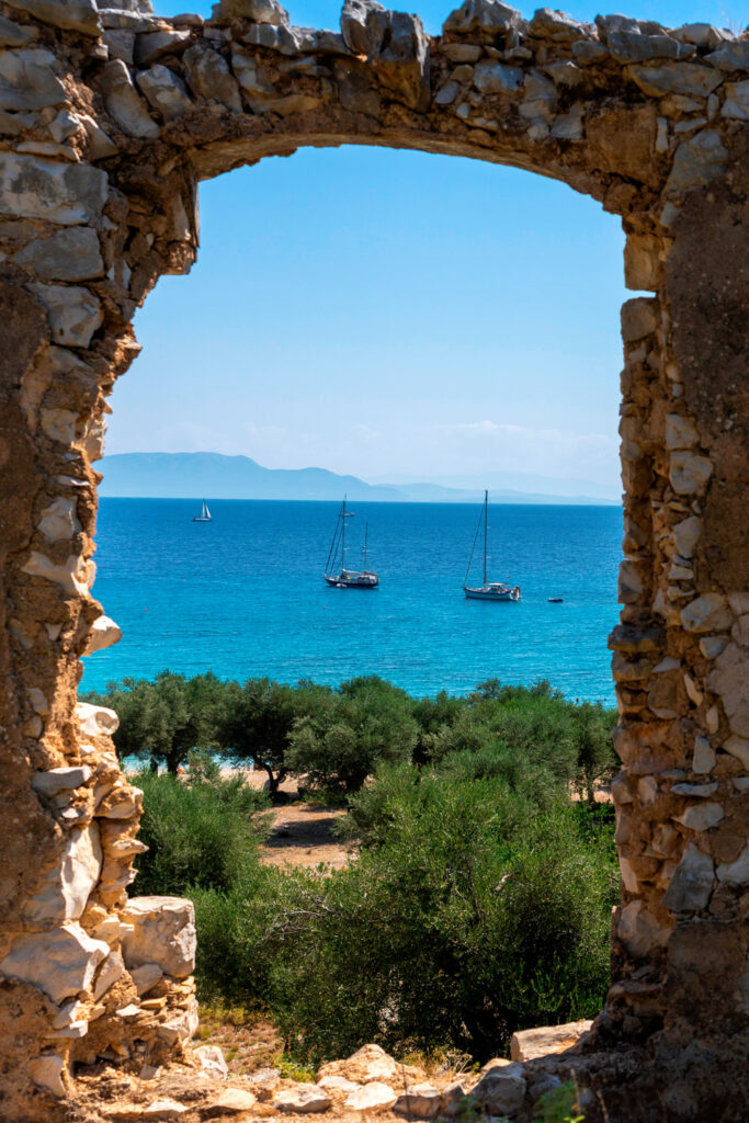 View through an ancient doorway at Filiatro beach, Ithaca, Ionian Sea Greece