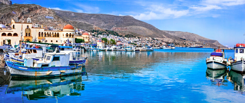 Traditional fishing boats in Kalymnos harbour Pothia, Dodecanese Greece
