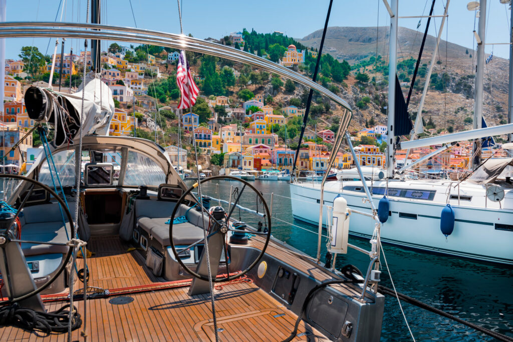 Sailboat in the port of Symi island, Dodecanese Greece
