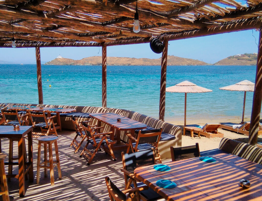 A sun dappled beach bar on a summer day in Kea island, Cyclades Greece