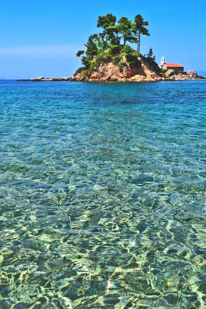 Agiou Nikolaou islet opposite Elinika beach in Evia, Central Greece