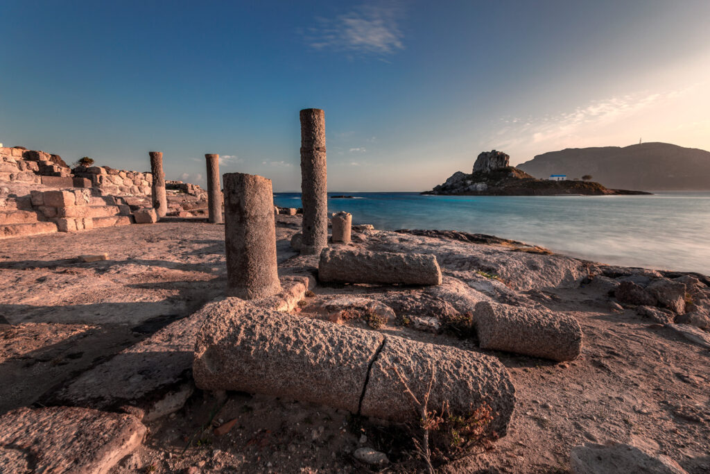 Ancient ruins at Agios Stefanos in Kefalos Bay in Kos, Islet of Kastri in the background, Kos, Dodecanese Greece