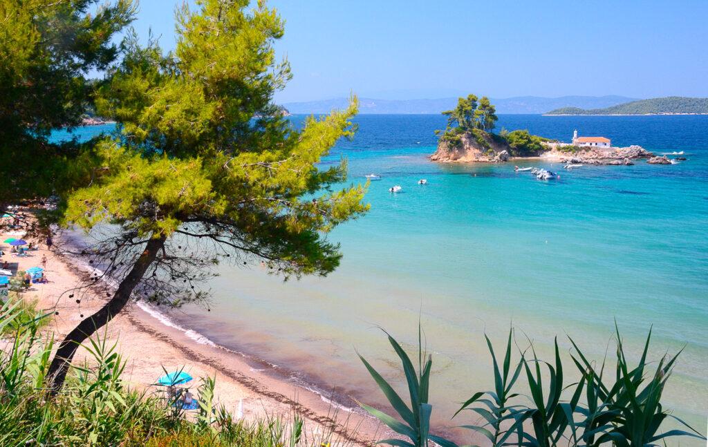 Beautiful islet with church of Agios Nikolaos opposite Elinika beach in Euboea, Greece