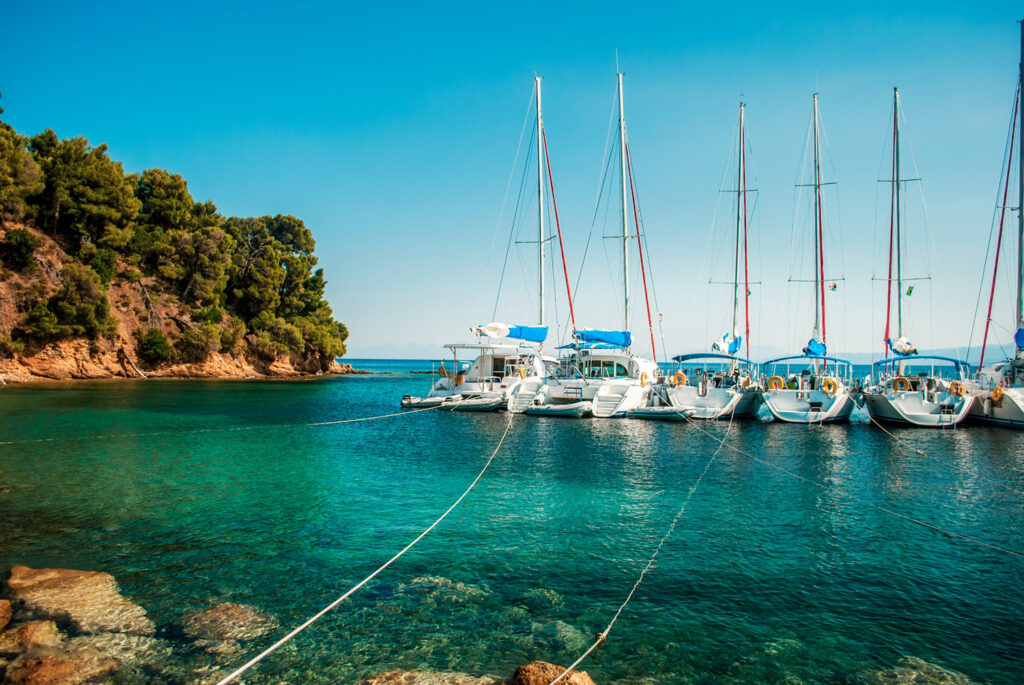 Blue sea with yachts and boats on the water in Skiathos, Sporades Greece