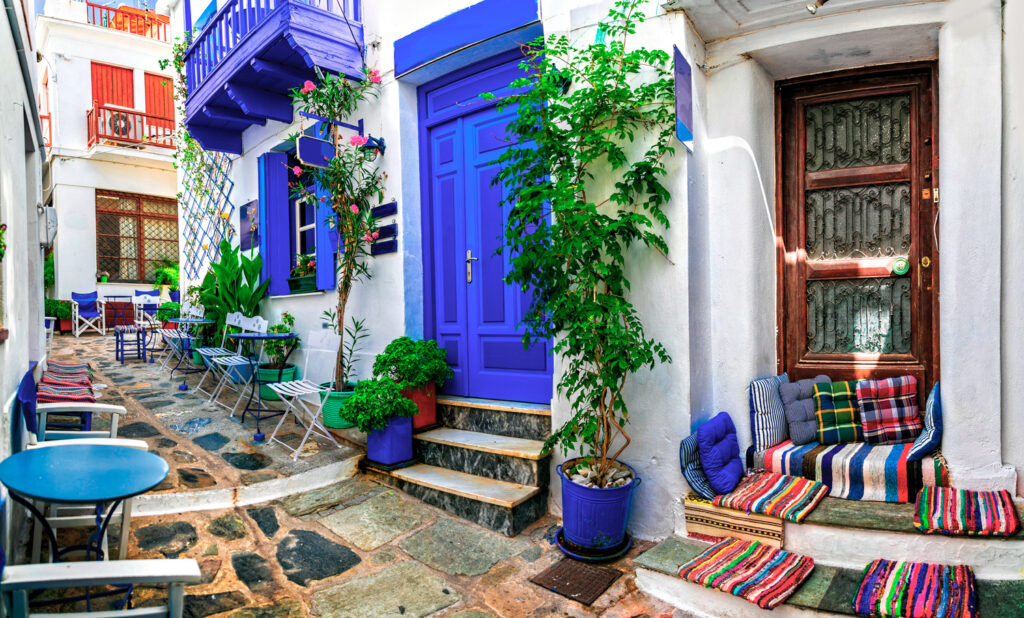 Traditional narrow streets with picturesque cafes and bars in Skopelos, Sporades Greece