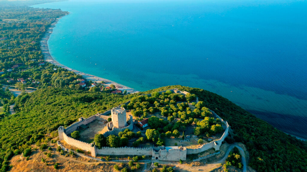 Aerial view of iconic and historic medieval castle of Platamonas built in the slopes of Mount Olympus in Pieria area, North Greece