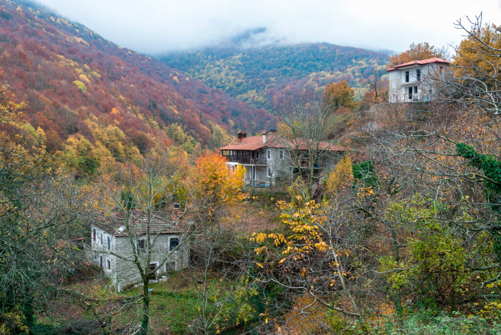 Autumn landscape with old traditional stone houses in Skotina village, near Mount Olympus in Pieria, Macedonia Greece