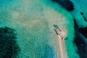 Aerial view of the beautiful Karidi beach in the Vourvourou of Chalkidiki, Greece. Visit the summer hundreds of tourists daily from the Balkans and from Europe