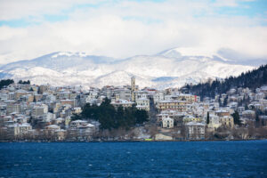 Kastoria in Greece covered with snow and lake of Orestiada, West Macedonia, Greece