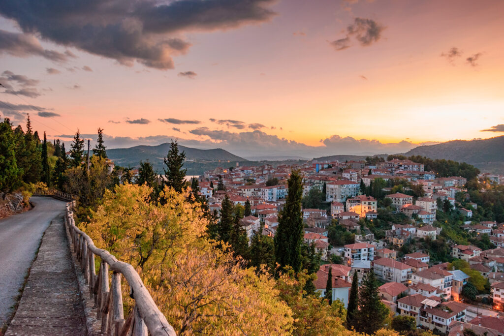 Scenic view of Kastoria town and the famous Orestiada lake in fall season against a cloudy sky. West Macedonia, Greece