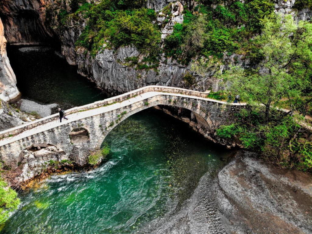 Portitsa Grevena stone bridge in the Pindos mountains, Grevena, West Macedonia Greece
