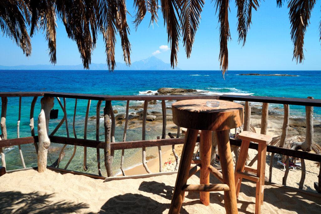 Tropical Beach bar view at Athos mountain/ Halkidiki coast Mediteranean sea, Chalkidiki Greece, Sithonia