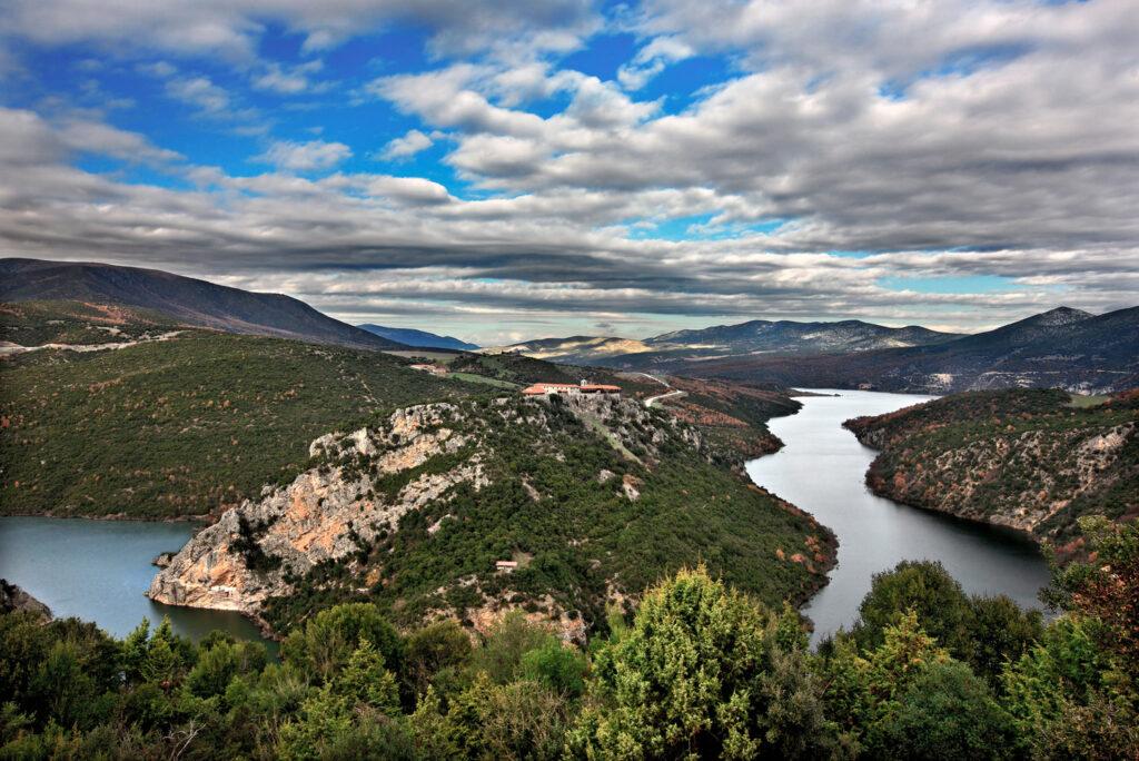 "Zavorda (""Saint Nicanor"") Monastery and Aliakmonas river, GREVENA, MACEDONIA, GREECE. turning into a lake after the construction of the new dam. Grevena, Macedonia, Greece"