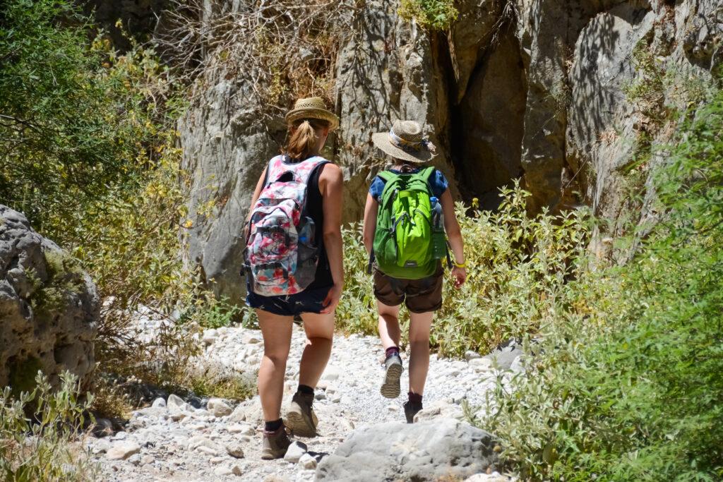 Tourists hiking in gorge, Crete Greece