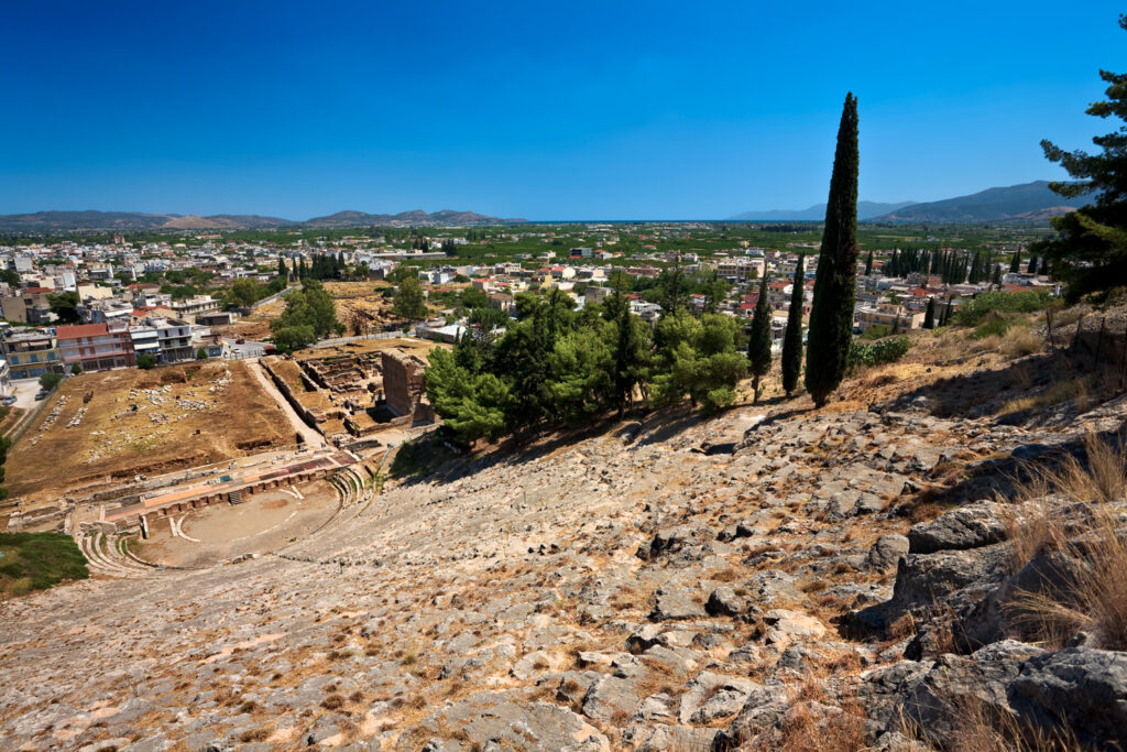 Greece. Argos. Remains of ancient Argos - ruins of the Hellenistic Theater, the Odeon and the Roman Baths. There are the modern city and Gulf of Argolis in the background