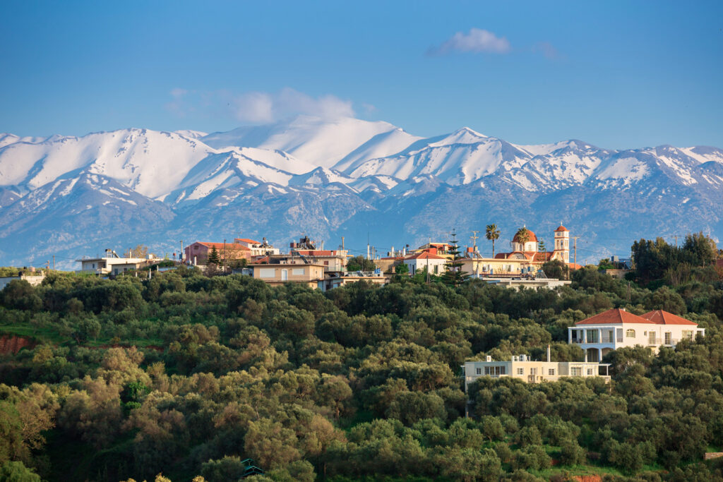 Greek village in Crete with the White Mountains on the backdrop, Greece