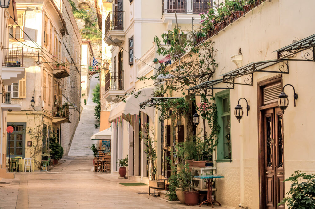 Nafplio - narrow cobblestoned alley with the neoclassical buildings of the old town, Peloponnese Greece