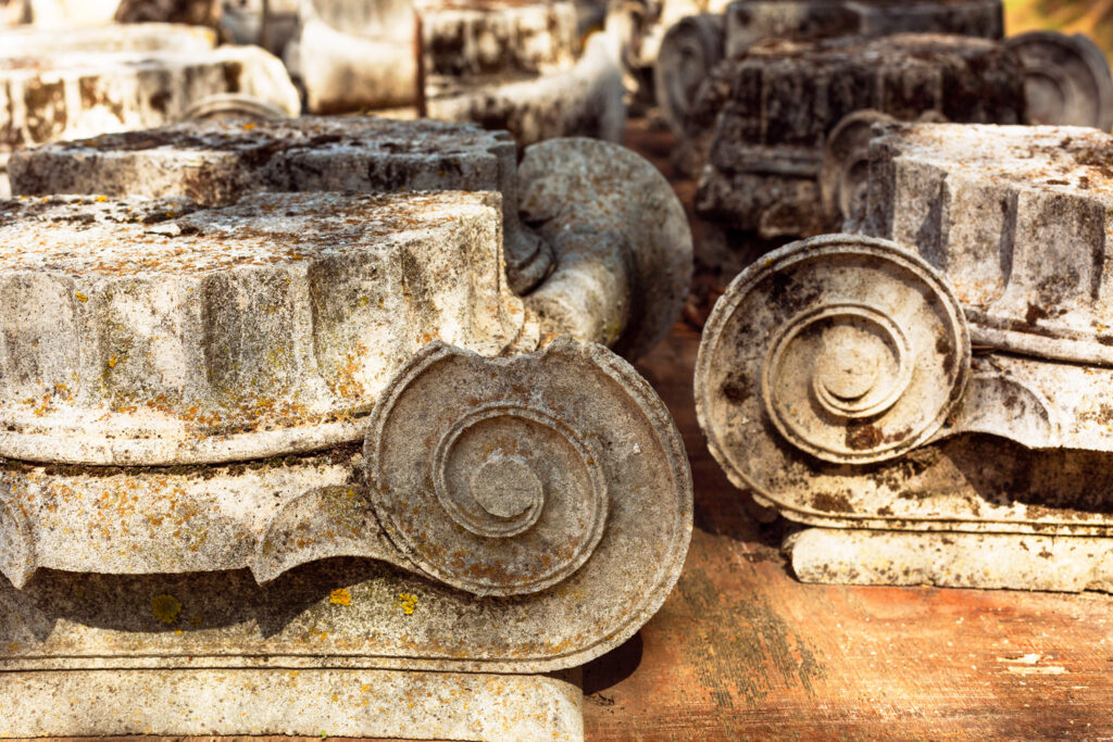 Parts of the destroyed marble columns in the Archaeological Museum of Epidaurus, Argolida prefecture, Peloponnese, Greece